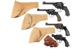 Four British Double Action Revolvers with Holsters