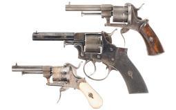 Three Cased Antique European Revolvers with Accessories