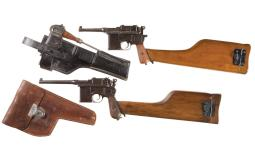 Two Mauser Broomhandle Pistols with Stocks