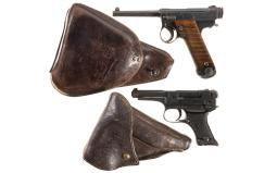 Two Japanese Type 14 Nambu Pistols with Holsters