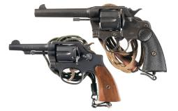 Two Military Double Action Revolvers with Lanyards