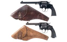 Two Colt New Service Double Action Revolvers with Holsters