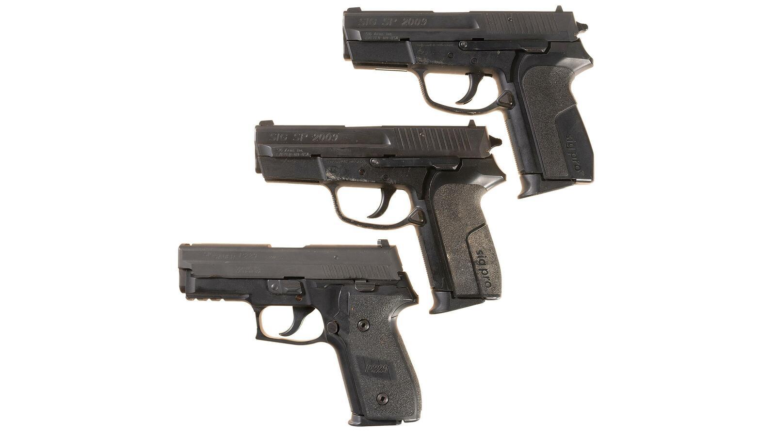 three sig arms semi automatic pistols