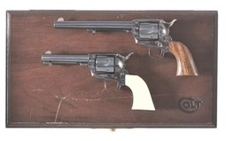 Two Miniature Replica Colt Single Action Revolvers