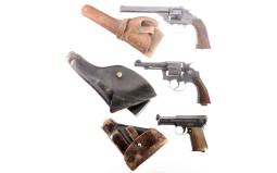 Three Handguns with Holsters