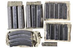 Assorted Thompson Magazines and Magazine Pouches