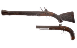 One Flintlock and One Percussion Pistol
