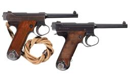 Two Semi-Automatic Japanese Military Pistols with Holsters
