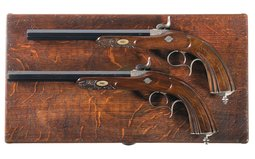 Cased Pair of Engraved and Carved Parisian Percussion Pistols