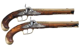 Gilded Pair of Bohemian Percussion Pistols