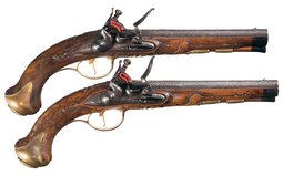 Pair of Damascus Barreled Flintlock Pistols with Gilt Furniture