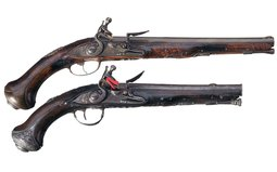 Two Ornate French Flintlock Pistols with Gold Accents
