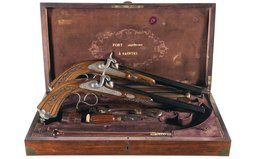 Cased Pair of Engraved and Carved European Percussion Pistols